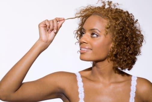 05-24-12-smiling-womna-pulling-hair-1814095-9564494
